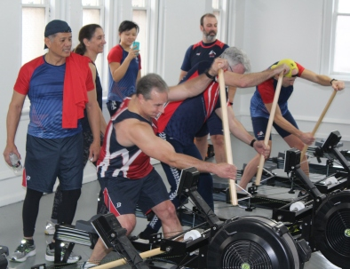 Men stand up and use an indoor rowing machine with a paddle attachment. What you eat and when you eat it is important for top performance while exercising.