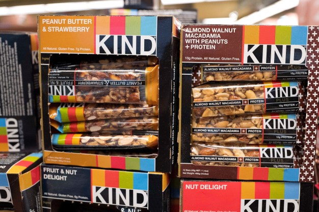"Kind snack bars are displayed in a New York supermarket, Thursday, Feb. 9, 2017. Kind CEO Daniel Lubetzky is pledging $25 million over the next 10 years to create a nonprofit dedicated to ""revealing and countering"" the food industry's influence on public health. The move underscores the division between ""Big Food"" companies and newer players that market themselves as wholesome alternatives aligned with public health. (AP Photo/Mark Lennihan)"