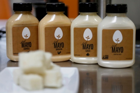FILE - This Feb. 4, 2015, file photo, shows Hampton Creek Foods bottles of Just Mayo flavors at their office in San Francisco. In 2014, the Association for Dressing and Sauces repeatedly complained to the FDA that an eggless spread was calling itself Just Mayo, noting that under the federal rules mayonnaise is defined as having eggs. The maker of Just Mayo worked out an agreement with the FDA to keep its name, with some strategic tweaks to its label to make clear it does not contain eggs. (AP Photo/Jeff Chiu, File)